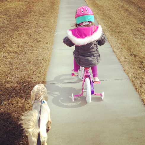 Riding her bike on a warm February day.